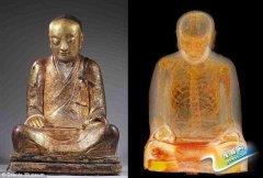 千年佛像内现打坐和尚真身 体内藏纸张写有汉字