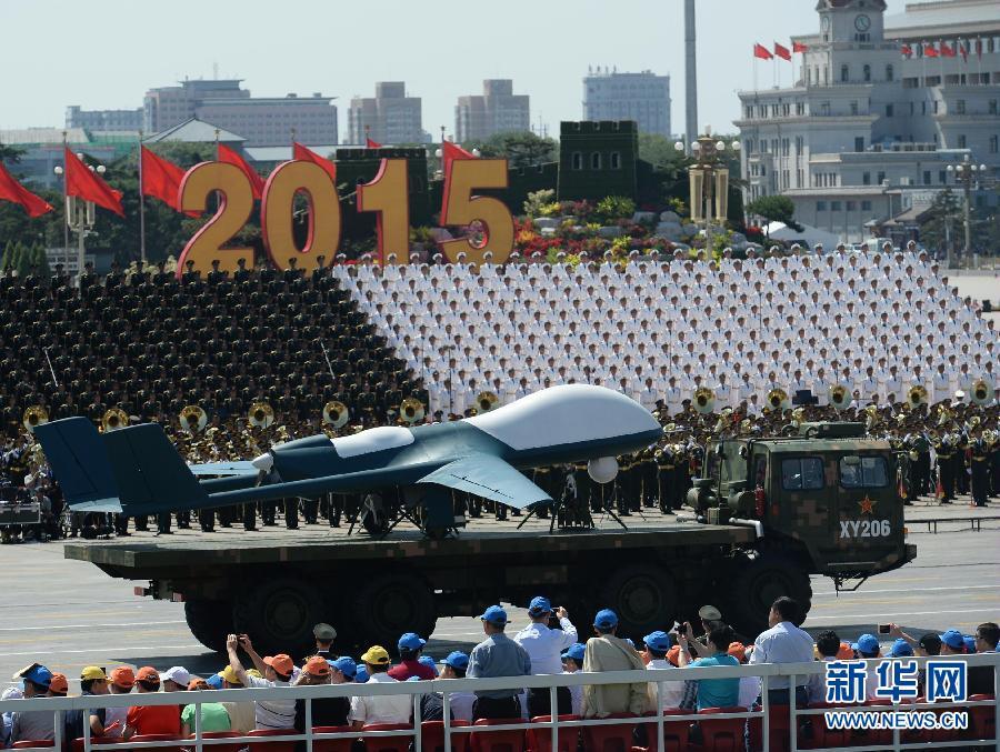 9月3日,中国人民抗日战争暨世界反法西斯战争胜利70周年纪念大会在北京隆重举行。这是无人机方队接受检阅。 新华社记者 刘潇摄