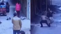实拍男子当街拽掉女子短裙 事后拔腿就跑