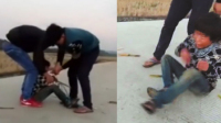 实拍男童惨遭多名男子殴打 手脚被捆绑扔进水沟