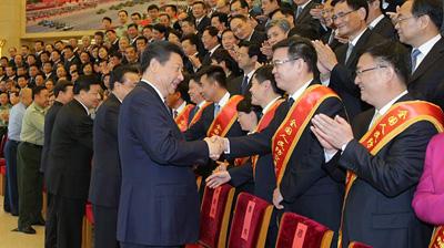 习近平会见第七次全国人民防空会议代表