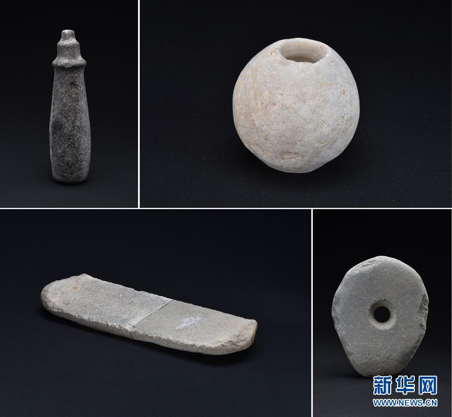 这是新疆尼勒克县吉仁台沟口青铜时代聚落遗址出土的石器(资料照片)。新华社发