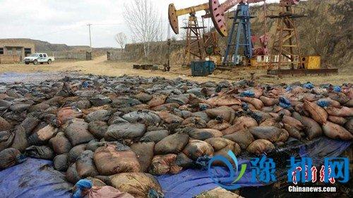 资料图:2015年3月26日凌晨,位于陕西省吴起县的中国石油长庆油田分公司第九采油厂发生原油泄漏事故。
