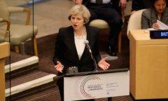 """英国首相呼吁管控边境 全球联合应对""""移民失控"""""""