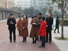 光明日报河南站和市教育局领导一行采访报道我区学校德育工作