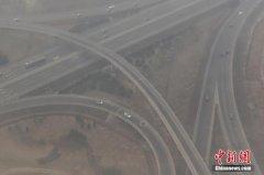 中国长江以北出现大风降温 暂别雾霾天